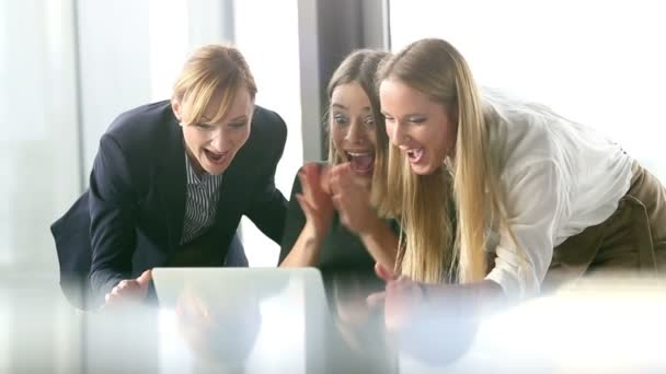 business women high-fiving in office