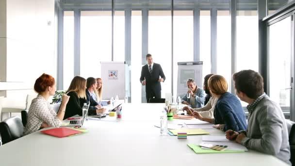 Business people applauding director