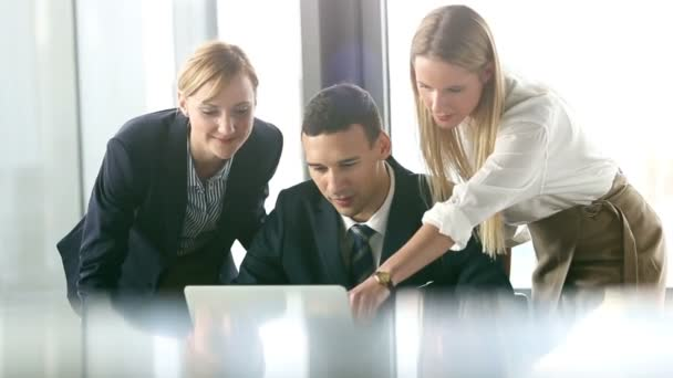 business people looking at laptop