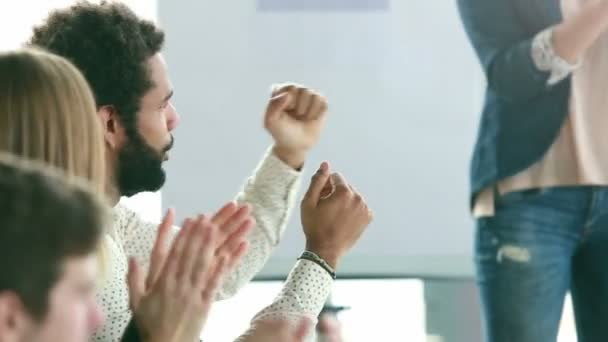 man clapping with colleagues