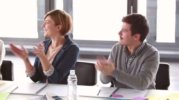 colleagues applauding after presentation