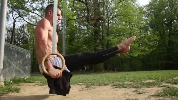 Man doing handstand on gymnastics rings