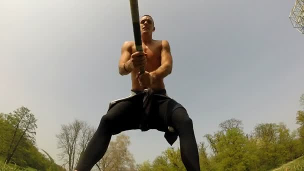 Strong man hitting with hammer