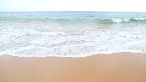 Waves washing over white sand