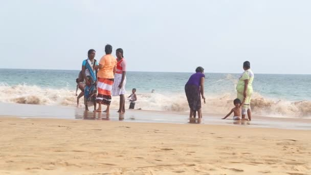 Locals enjoying the beach and playing in the surf.
