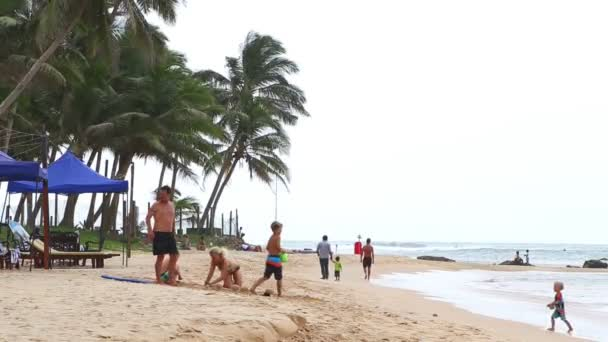Tourists playing on beach  with sand