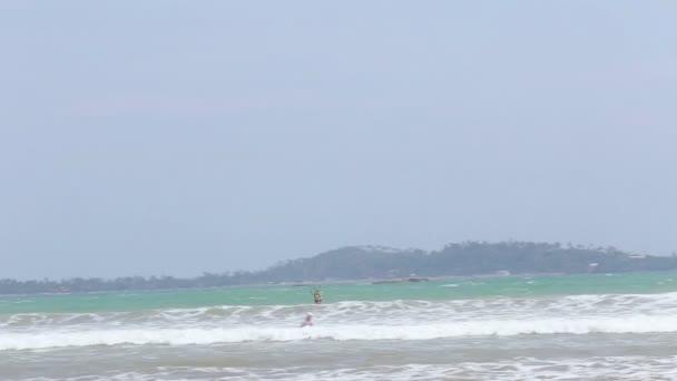 Kitesurfer jumping in the waves