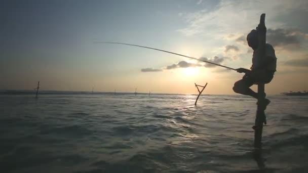 Rybář na udici