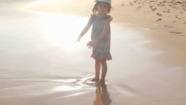 Little girl walking on a beach in Mirissa