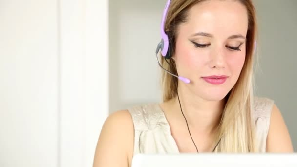 Woman with headphones on computer talking to customer