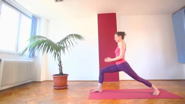 Woman doing yoga asanas in hall