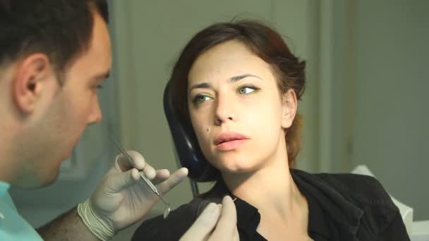 Woman at dentists surgery
