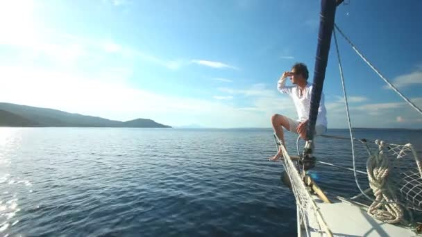 Man on the bow of sailing boat