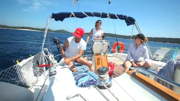 Young adults enjoying trip on sailing boat