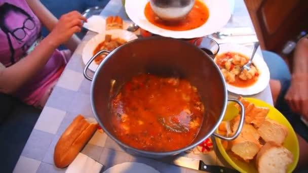 People enjoying freshly cooked meal