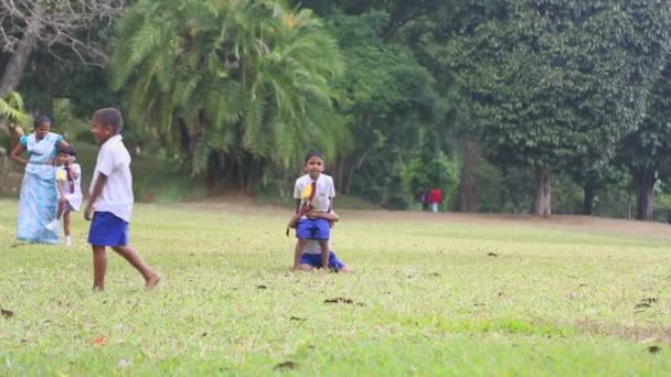 Children in school uniform playing in the Botanical Gardens