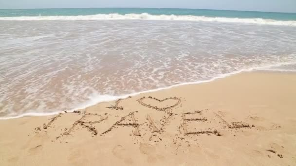 I LOVE TRAVEL written on beach