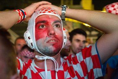Croatian football fan in water polo cap