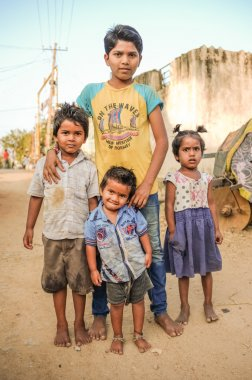 Three Indian boys and little girl