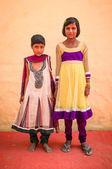 Two Indian girls pose