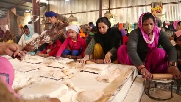 Group of people preparing dough