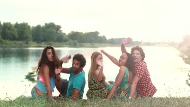 friends sitting on grass