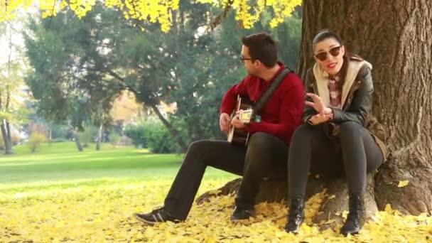 woman singing and man playing guitar