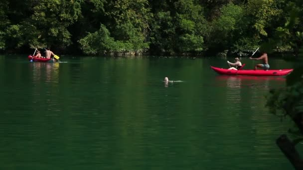 adults riding canoes