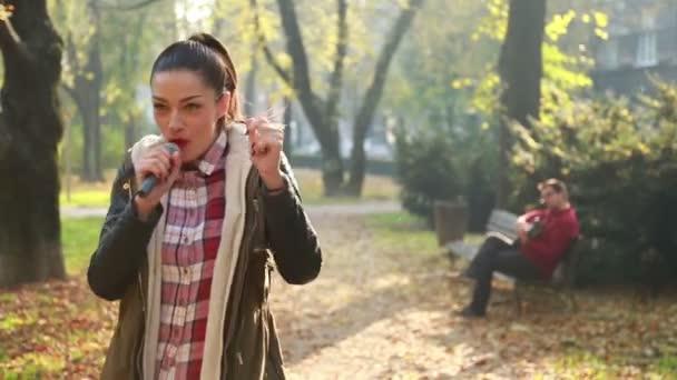 woman singing while man playing guitar