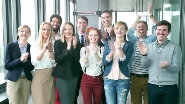 business people clapping in office