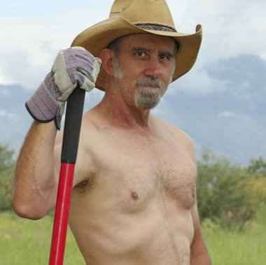 A Shirtless Cowboy Pauses While Working on the Ranch