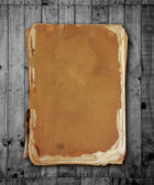 Vintage book on wood with clipping path.