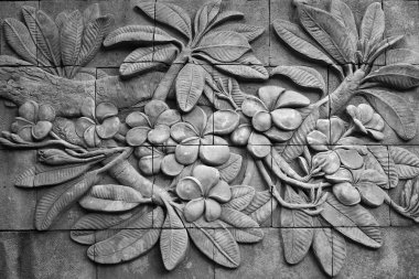 Black and white of low relief cement Thai style handcraft of plu