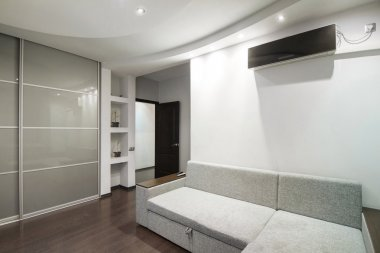 Interior modern, light gray room with air conditioning