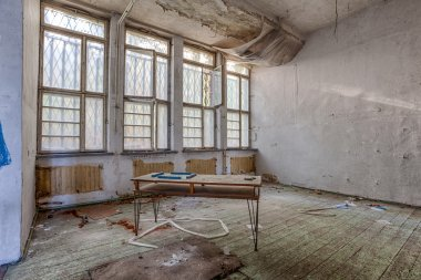 Demolished room with wooden floors