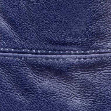 Dark violet leather texture closeup, seam stock vector