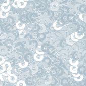 Bledě modré pozadí látky zdobené flitry