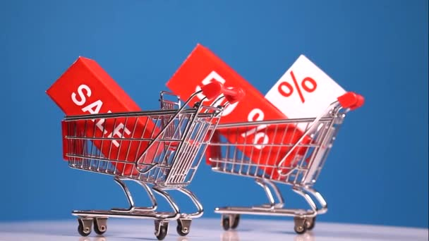Moving shopping carts with sales icons
