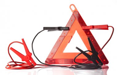 Warning triangle and jump start cable isolated on white