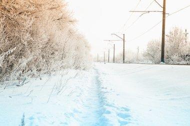 Winter trail along the railroad