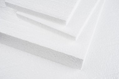 Closeup white foam on cardboard stock vector