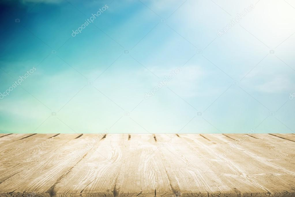 Wooden table with beautiful cloudy sky