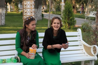 Ashgabad, Turkmenistan - October 10, 2014. Two young girls in na