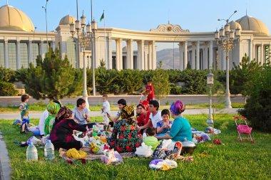 Ashgabad, Turkmenistan - August 1, 2014. Happy big family picnic