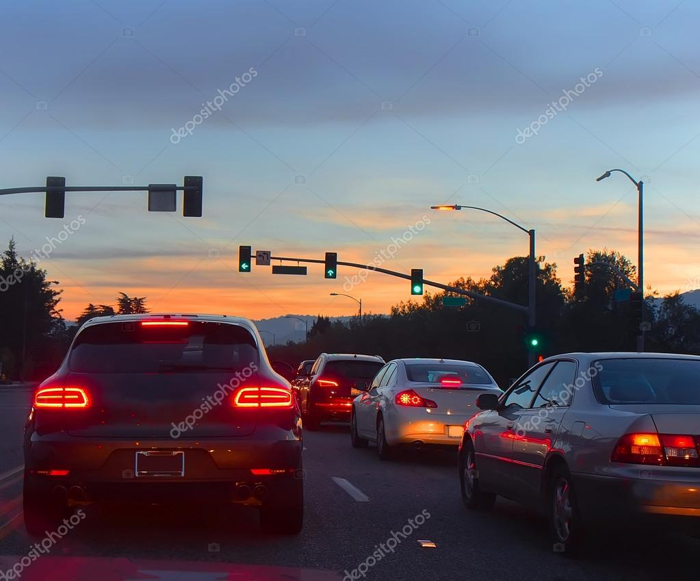 Road with cars in evening traffic
