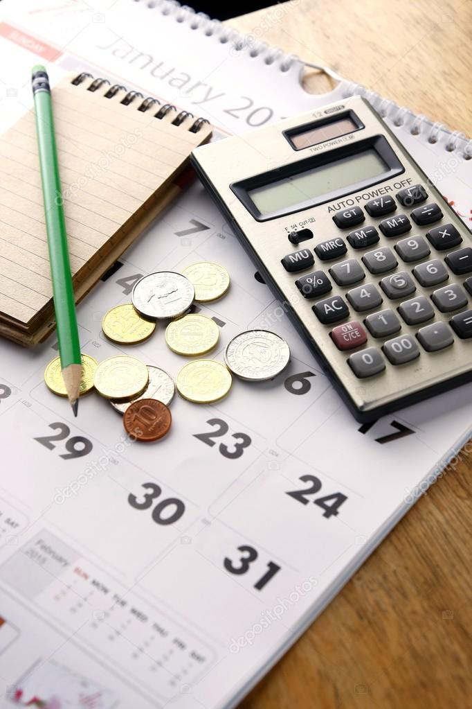 Notebook Calculator Calendar Pencil And Coins Stock Photo