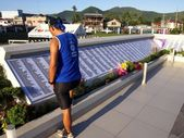 A man reads the names in a monument in remembrance of those who perished in the storm surge brought by typhoon Yolanda