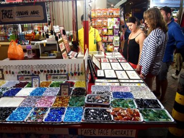 Tourists choose from a variety of souvenir products at a store or shop in Chinatown, Singapore.