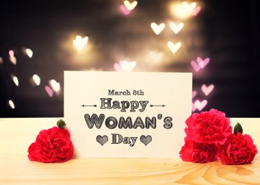 Womans Day message card with carnation flowers