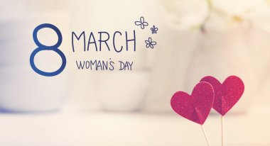 Womans Day message with small red hearts